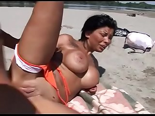 Italian stallion fuck on the beach black hair milf with gorgeous and big tits