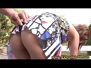 Asian model babe fingered in public on park bench