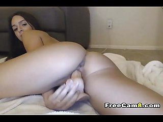 Sexy model spreads her legs and play her smooth cunt