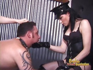 Two ravishing babes enjoy spanking a latex clad horny stud hard