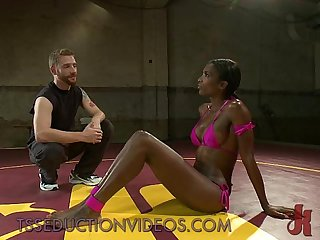 Busty black tranny in pink bikini sucks and fucks guy on mats