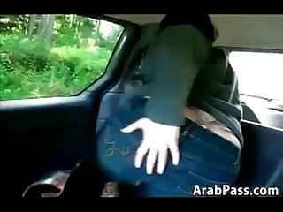 Naughty arab fisting her own ass in a car