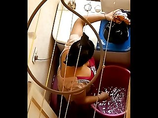 Big ass aunty washing clothes in balcony