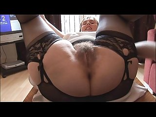 Hairy busty mature lady in slip and girdle does upskirt and striptease show