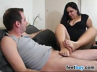Chubby wife gives a footjob and handjob