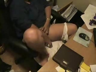 Hidden cam catches my horny mom masturbating at her desk