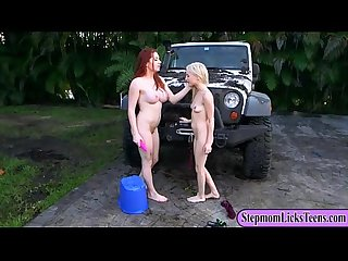 Busty redhead mommy and blonde teen lesbian session outside