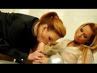 Classy clothed lesbian sucks plastic cock in threesome