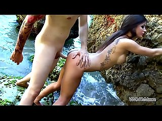 Stunning hot babe fucked on the rocks by the see cum fed