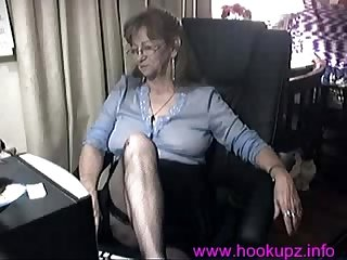Horny granny finger fucks her mature pussy