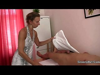 Granny masseuse jumps on his cock