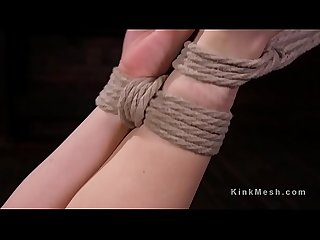 Hogtied brunette caned and toyed