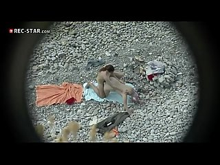 Couple fucking at the beach with facial