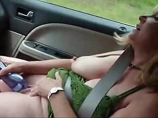 Horny mature wife masturbates in car