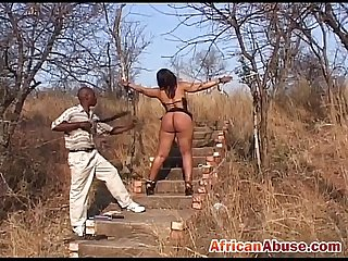 Black sex slave gets tied to tree and spanked by husband
