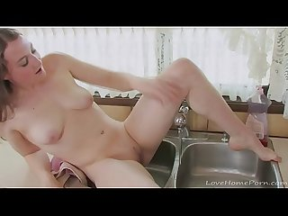 Amateur brunette uses the sink to cum