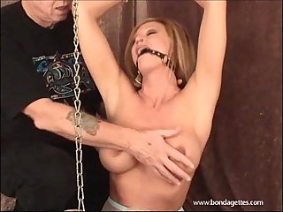 Erotic bondage and ballgagged domination of kinky damsel in distress struggling