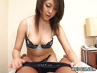 Asian handjob with a pinch of a titty fuck