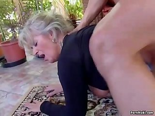 Big titted mom takes young cock