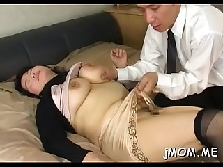 Nice looking Asian older plays with water on her juicy pussy