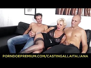 CASTING ALLA ITALIANA - Mature Italian blonde gets DP and cum on feet in hot FFM threesome