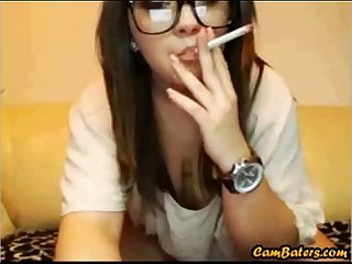 Sexy teen with glasses smokes and masturbates