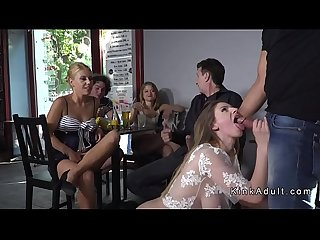 Slave flashing huge tits in public
