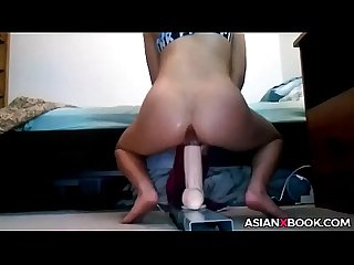 Sexy asian GF rides huge dildo