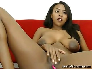 Busty ebony babe masturbates on webcam