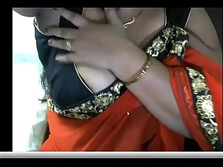 Indian hot Aunty pressing and showing her boobs to lover guy on webcam