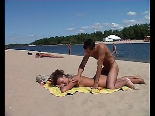 Nudist teen not shy about posing nude at the beach