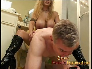 Latex clad busty wench fucks a horny stud with a strap on