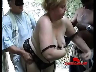 Outdoors fat granny enjoys black and white cocks