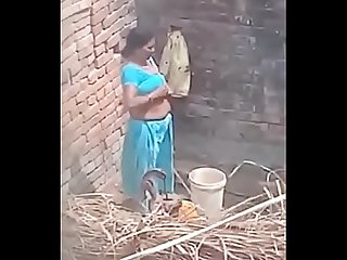 My neighbour Aunty bathing showing her big boobs period