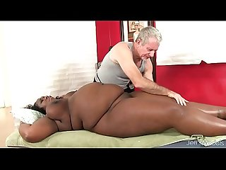 Big bellied black girl Daphne Daniels gets a sex massage