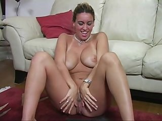 Tanned babe with big tits gives Joi