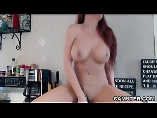 Redhead with big tits rides toy on kitchen counter