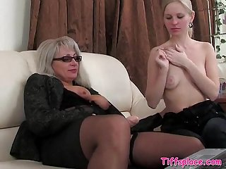 Young blonde rides older lesbians strapon