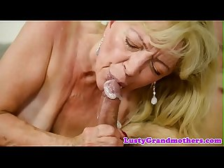 Saggy grandma receives cum in mouth