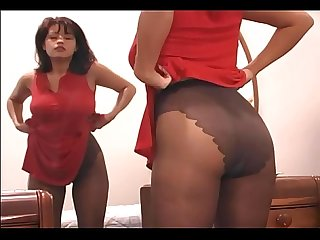 Busty brunette fingering her pussy in pantyhose