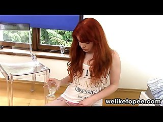 Redhead piss squirting through panties