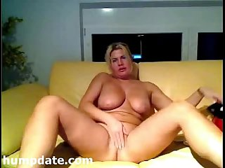 Blonde MILF with big tits masturbating on cam