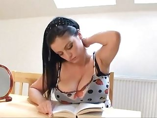 Big tit brunette playing with herself while reading