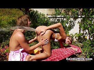 Milk squirting les straponfucked outdoors